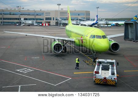 MOSCOW, RUSSIA - MAY 03, 2016: Towing aircraft Airbus A319 (VP-BTV) on the runway from the terminal at Domodedovo airport
