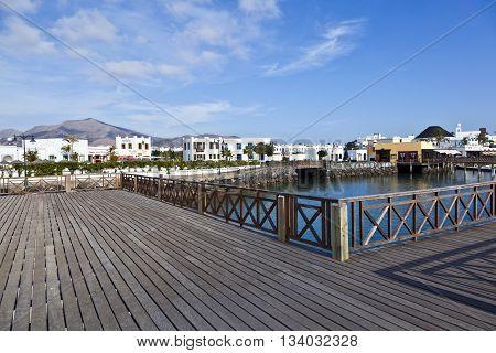 new harbor in Playa Blanca under blue sky