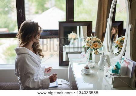 Beautiful Bride Near A Mirror