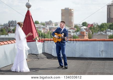 Bride And Groom On The Roof