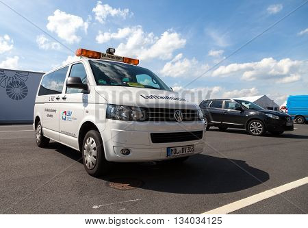 BERLIN / GERMANY - JUNE 3 2016: an civil aviation authority car stands on airport in schoenefeld / berlin germany at june 3 2016.