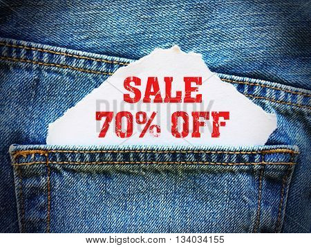 70% off on white paper in the pocket of blue denim jeans