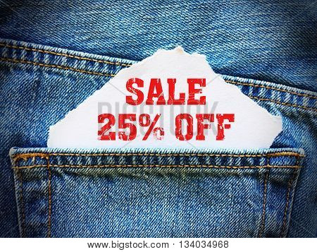 25% off on white paper in the pocket of blue denim jeans