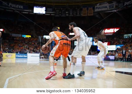 VALENCIA, SPAIN - JUNE 9th: San Emeterio with ball and Llull during 4th playoff match between Valencia Basket and Real Madrid at Fonteta Stadium on June 9, 2016 in Valencia, Spain
