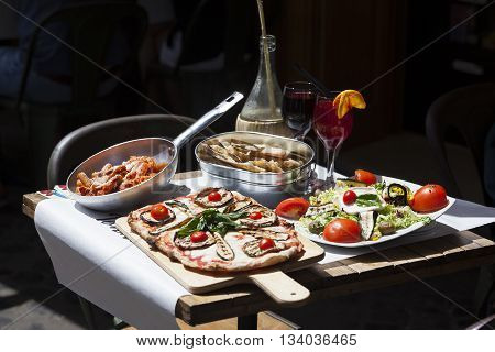 traditional italian food in outdoor restaurant, Rome, Italy.