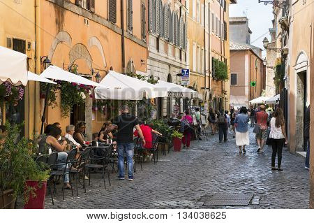 ROME ITALY - MAY 27 2016: Tourists and restaurants on a street in the city center.