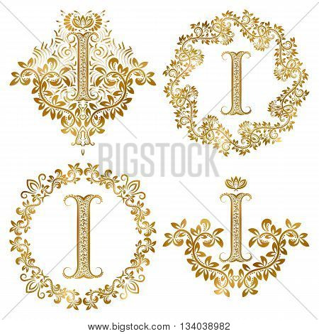 Golden letter I vintage monograms set. Heraldic monogram in coats of arms form letter I in floral round frame letter I in wreath heraldic monogram in floral decoration with crown.