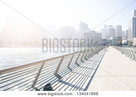 empty footpath on bridge with cityscape and skyline of san francisco