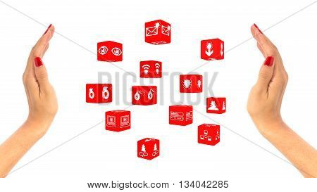 Two female hands with red fingernails enclosing red cubes with cybersecurity icons