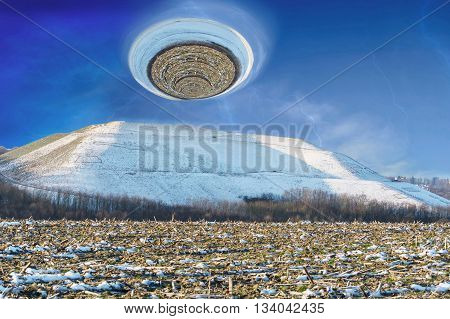 Photomontage landscape picture of a snowy mountain over it a giant hurricane