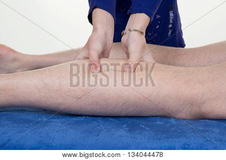 Hands Massaging Human Calf Muscle.therapist Applying Pressure On Male Leg.