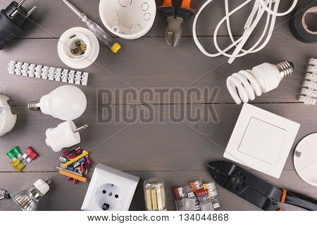 top view of electrical tools and equipment on wooden table
