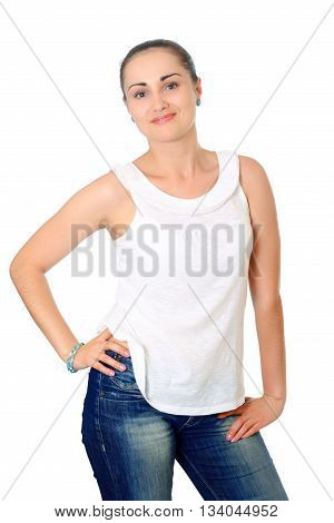 young woman with dark hair in t-shit and jeans posing. Half-lenght portrait on white background, isolated