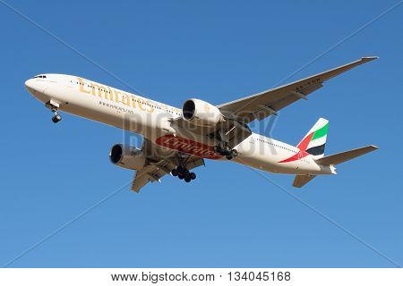 SAINT PETERSBURG, RUSSIA - MARCH 20, 2016: Boeing 777-31HER Aircraft (A6-EGN) Emirates Airline in flight