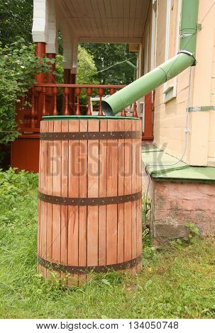 Old rainwater barrel near country house, Russia