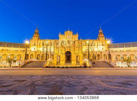 Facade of Spanish Square espana Plaza in Sevilla Spain at dusk