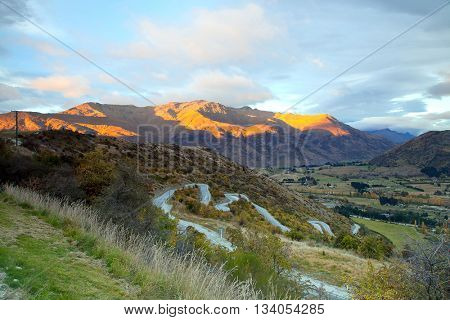 Aerial view of Highway Road Freeway to Arrow Town with Sunrise Mountain range Landscape New Zealand