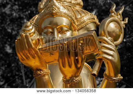 Golden Buddhist Statues Showing Colorfull Designs And Traditional Art And Design.