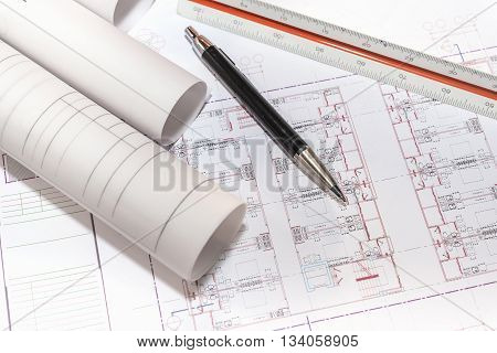 blueprints paper and blueprints rolls with pen and ruler on table the past of architectural project construction and renovation concept