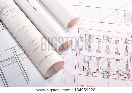 blueprints and blueprints rolls on table the past of architectural project construction and renovation concept