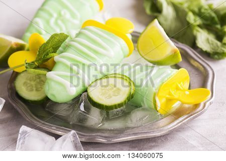 Refreshing lime and cucumber green ice pops