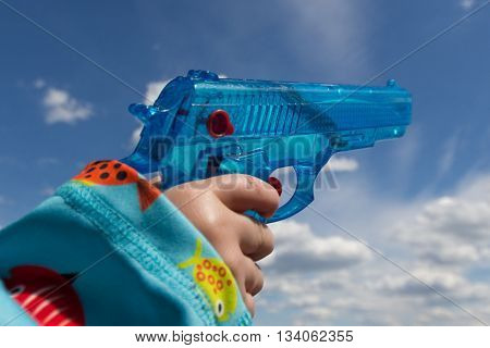 Child Hand Holding Toy Gun / Water Pistol