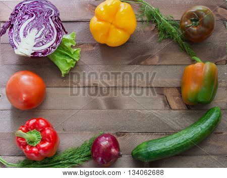 A few vegetables flanking the wooden background