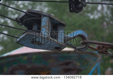 Old rusted metal windlass of blue color