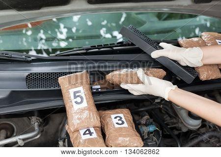 Drug smuggled in a car's engine compartment. Drug stash spot.