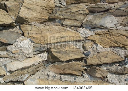 Stone Brick Wall made of fragment stones in irregular shapes