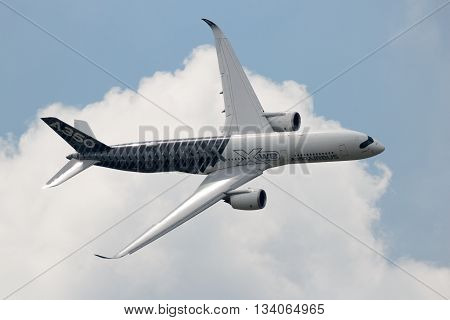 BERLIN - JUN 2 2016: Airbus A350 XWB flyby after take off at Berlin-Schoneveld airport.
