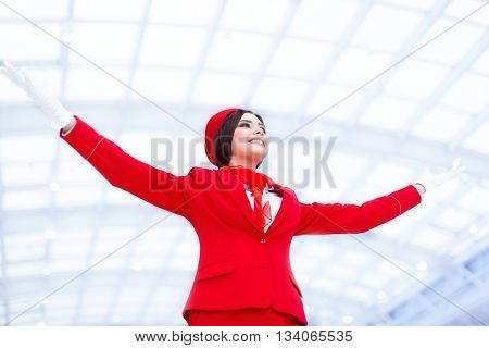 Young stewardess in a form at airport