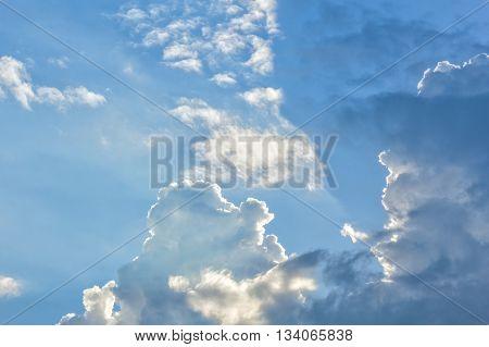 Scenic cumulus clouds in a blue evening sky