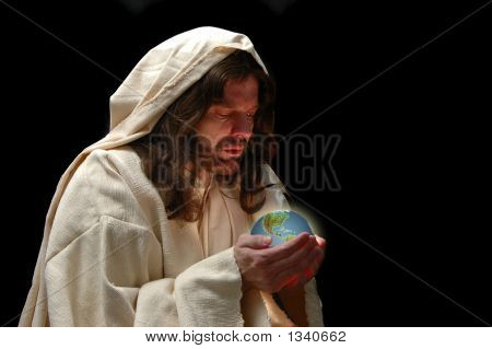 Portrait Of Jesus Holding The World