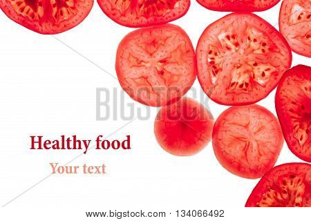 Decorative frame of slices of tomatoes on a white background. Isolated. Tomatoes sliced circles. Frame border from vegetables. Food background.