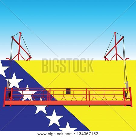 The wall of the industrial building is painted in the colors of Bosnia and Herzegovina national flag.