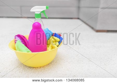 Carpet cleaners in a basin on a carpet.