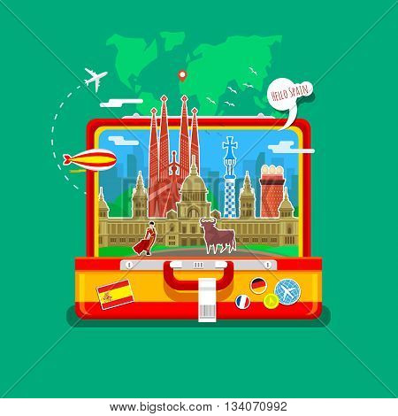Concept of travel to Spain or studying Spanish. Spanish flag with landmarks in open suitcase.