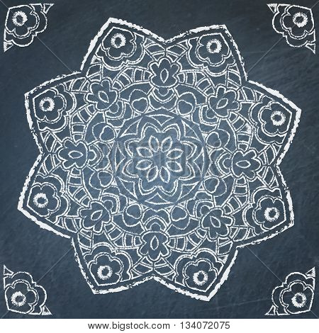 Symmetric filigree hand drawn ornament on chalkboard