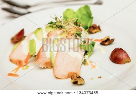 Sliced Chicken Appetizer with Apples Grapes and WalnutsSliced Chicken Appetizer with Apples Grapes and Walnuts with dressing