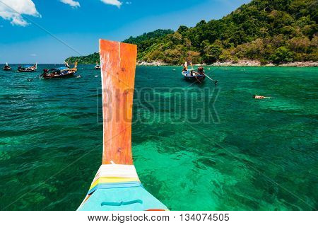 Snorkeling spot where boat dock and let travellers snorkling around to see colorful coral and marine life under water at Lipe island Satun Thailand
