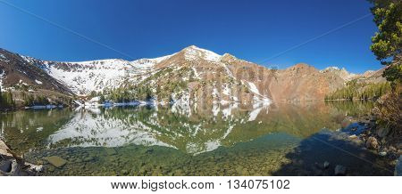 Beautiful vivid reflection at Big Virginia Lake, Eastern Sierra Nevada. California, USA. Panorama