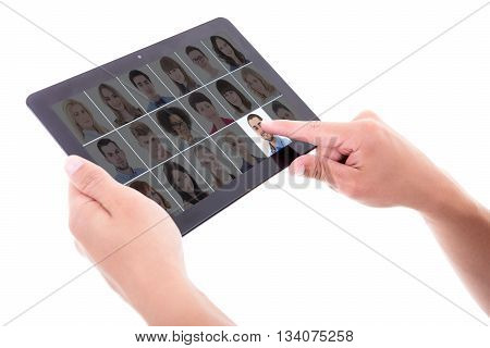 job search concept - businessman hand pressing buttons with people portraits on tablet pc screen isolated on white background