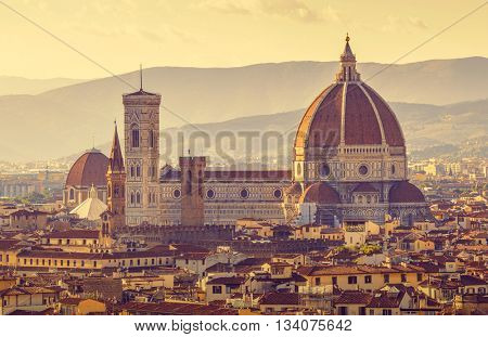 Retro-styled florence evening old town view to santa maria del fiore cathedral tuscany region italy