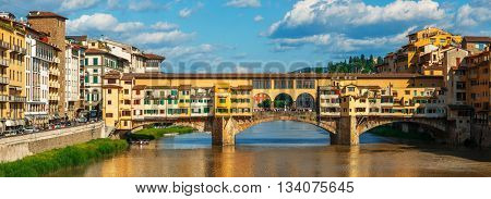 Panorama view to ancient bridge ponte vecchio at river arno in florence old town famous touristic place of tuscany region italy