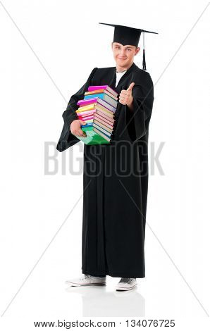 Full length portrait of a young graduation man holding books, isolated on white background