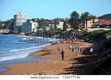 Sydney, AUSTRALIA - June 13, 2016. Disaster tourists after the big storm on Collaroy beach. The intense storm lashing the NSW coast has caused significant erosion at the Narrabeen and Collaroy Beach on Sydney's northern beaches last weekend.
