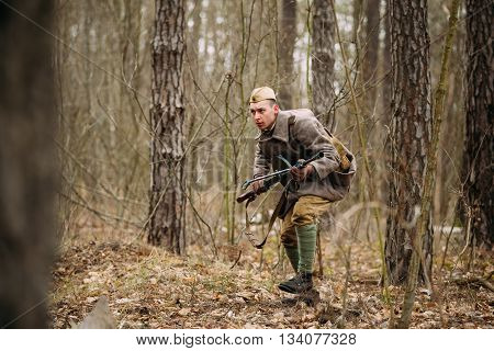 Pribor, Belarus - April, 05, 2015: Unidentified Re-enactor Dressed As Soviet Russian Soldier Running Through Woods