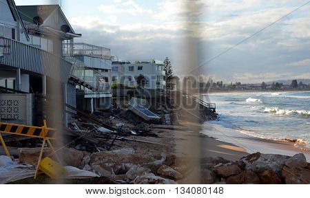 Sydney, AUSTRALIA - June 13, 2016. After the big storm, houses at Collaroy Beach front, behind the fence. The intense storm lashing the NSW coast has caused significant erosion at the Narrabeen and Collaroy Beach on Sydney's northern beaches last weekend.