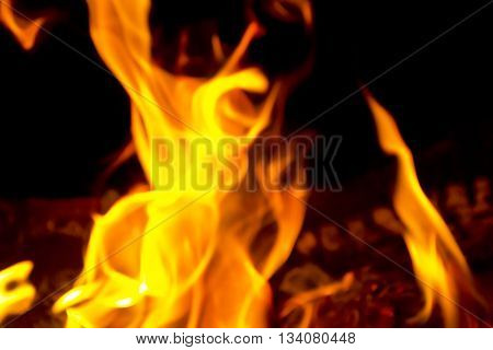 Photo of red fire flame on black background